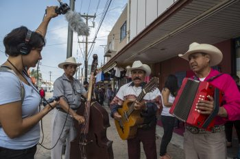 Photo of Erika Aguilar and musicians