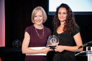 IWMF co-founder and Newshour anchor Judy Woodruff presents the 2016 Anja Niedringhaus Courage in Photojournalism Award to Adriane Ohanesian