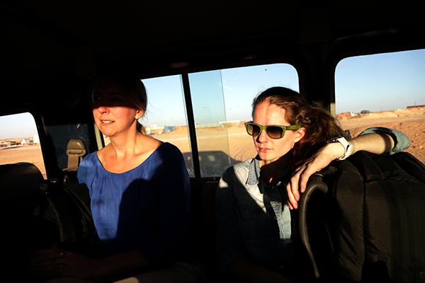 Journalists ride through the Sahara Desert