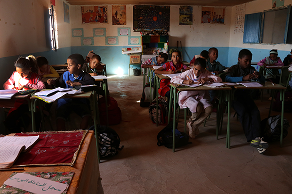 Fifth-grade students work in their math class in Dakhla camp in western Algeria on October 12, 2013.